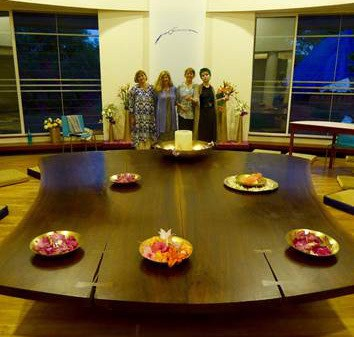 Miriam, Maddy and group infront of the Nakashima Peace table